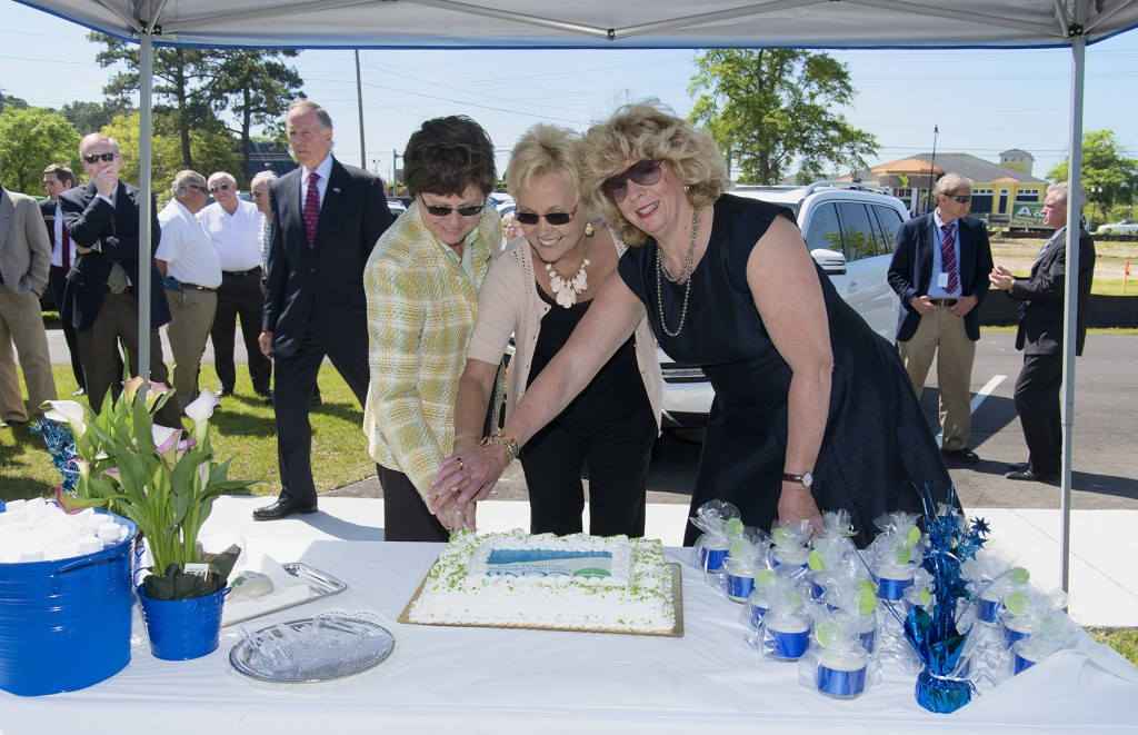 Shown from left to right: Henrietta U. Golding, Marilyn B. Hatley, and Marsha W. Griffin cut the cake at CCNB's groundbreaking ceremony.